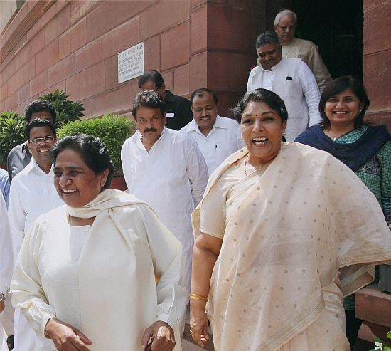 New Delhi: BSP supremo Mayawati and Congress MP Renuka Chaudhary at Parliament House in New Delhi on Thursday during ongoing monsoon session. PTI Photo by Kamal Singh(PTI9_5_2013_000062B)