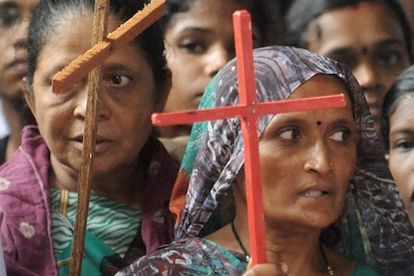 Indian Dalit - untouchable - Christians hold crosses during a protest rally against the National Commission for Scheduled Castes and Scheduled Tribes for its recent rejection of the demand for reservation for Dalit Christians and Muslims, in New Delhi on August 1, 2012. Thousands of protestors, church leaders, nuns, bishops and priests of the National United Christian Forum demanded that the United Progressive Alliance (UPA) government grant equal rights and reservation for the Dalit Christians and Muslims. AFP PHOTO/RAVEENDRAN